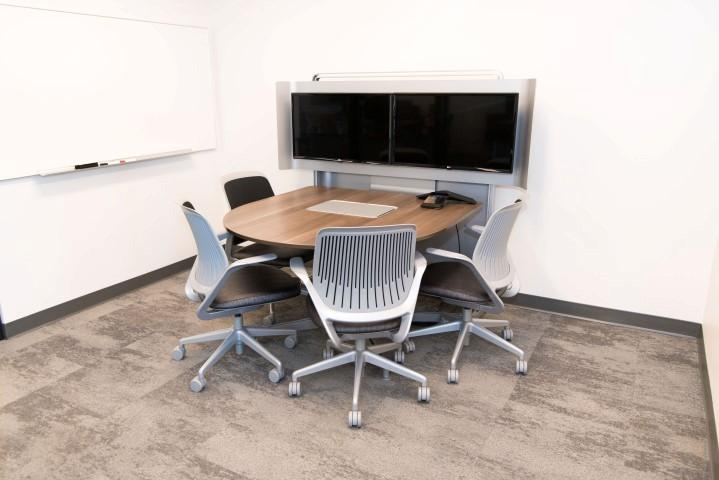 Small breakout areas let employees share media and work together away from the main group.