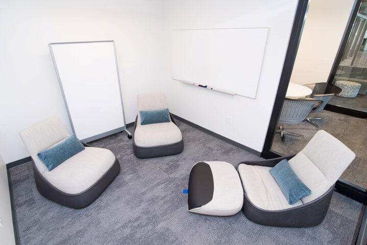 The low-tech conference rooms provide collaboration space for tasks like brainstorming.